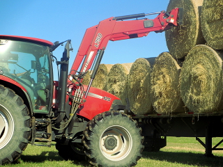 Loading Sherrill Farms hay in Texas